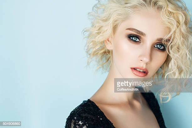 beautiful woman with make-up and stylish hairstyle - eye make up stock photos and pictures