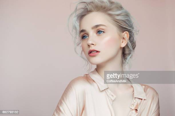 beautiful woman with make-up and stylish hairstyle - pretty blondes stock pictures, royalty-free photos & images