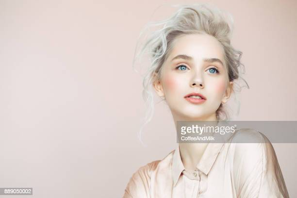 beautiful woman with make-up and stylish hairstyle - beauty photos stock pictures, royalty-free photos & images