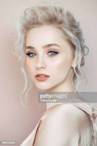 beautiful woman with make-up and stylish hairstyle - blonde hair stock pictures, royalty-free photos & images