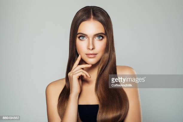 beautiful woman with make-up - straight hair stock pictures, royalty-free photos & images
