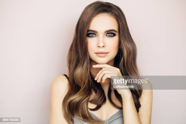 beautiful woman with make-up - long hair stock photos and pictures