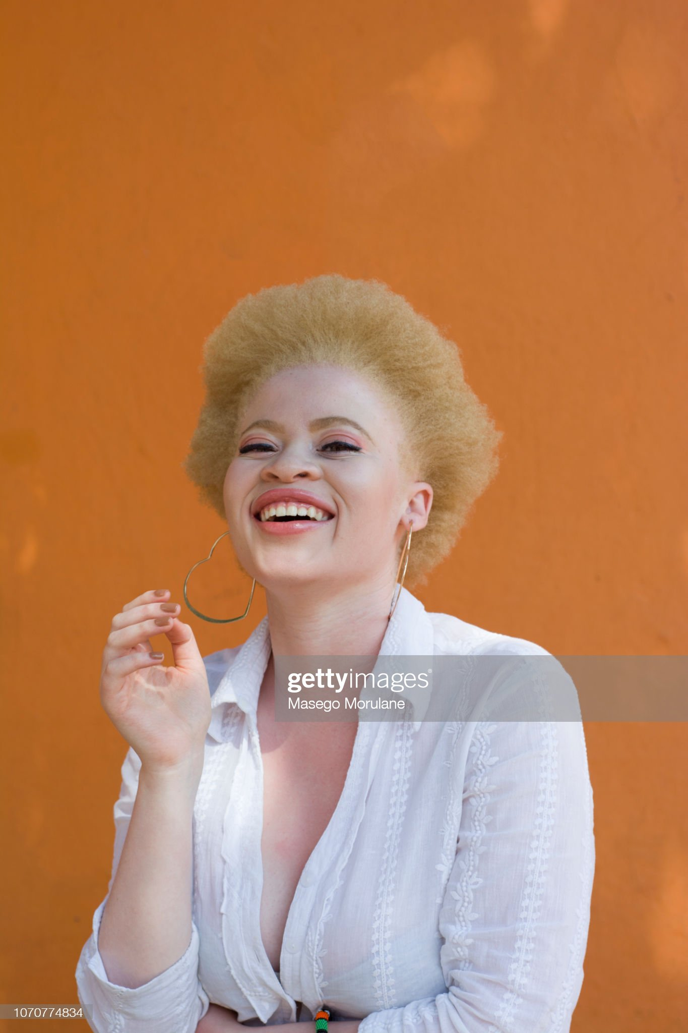 Beautiful woman with natural afro hair : Stock Photo
