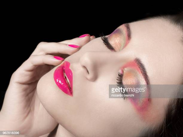 beautiful woman with pearl colored eyeshadow and fucsia lip gloss and polish - eyeshadow stock pictures, royalty-free photos & images