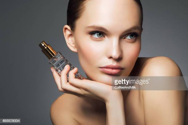 beautiful woman with perfume - stage make up stock photos and pictures