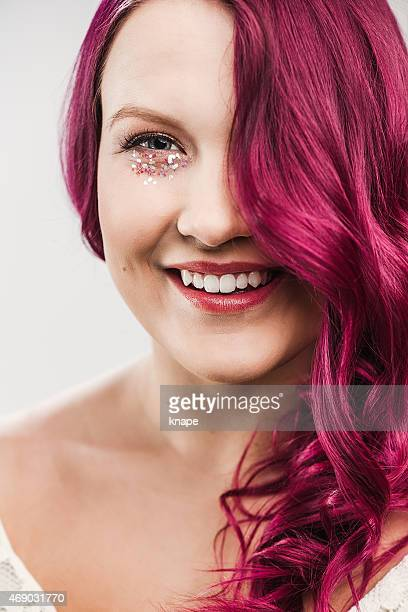 Beautiful woman with pink hair