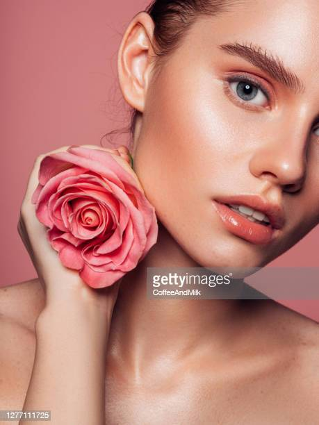 beautiful woman with pink rose - lip gloss stock pictures, royalty-free photos & images