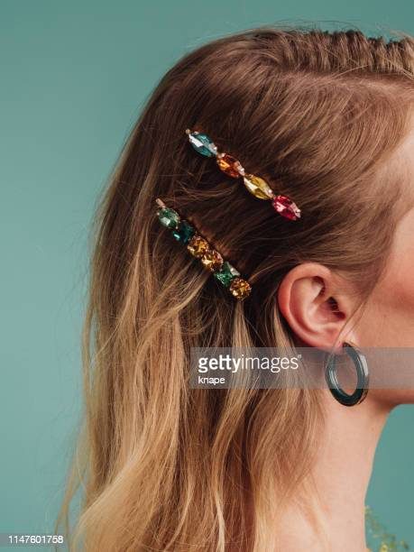 beautiful woman with pretty hairpin accessories - hairpin stock pictures, royalty-free photos & images