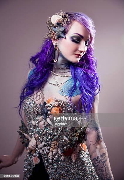 Beautiful Woman With Purple Hair Wearing Sea Costume