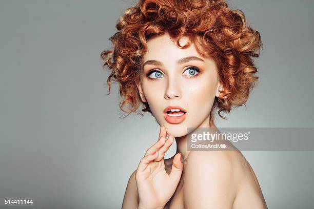 beautiful woman with red curly hair - redhead girl stock photos and pictures