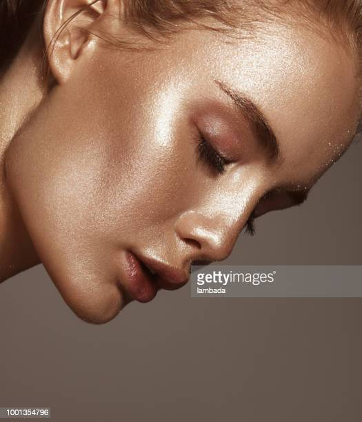 beautiful woman with shiny make-up - body paint stock pictures, royalty-free photos & images