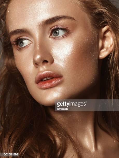 Beautiful woman with shiny make-up
