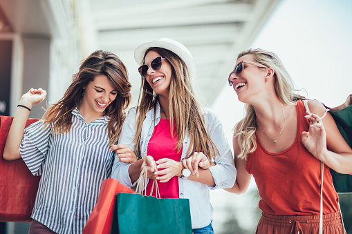 Beautiful woman with shopping bags in the city-sale, shopping, tourism and happy people concept 1131097418