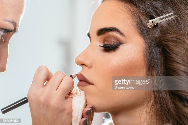 beautiful woman with smokey eyeshadow - lip liner stock photos and pictures