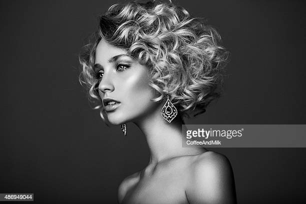 beautiful woman with stylish hairstyle - curly stock pictures, royalty-free photos & images