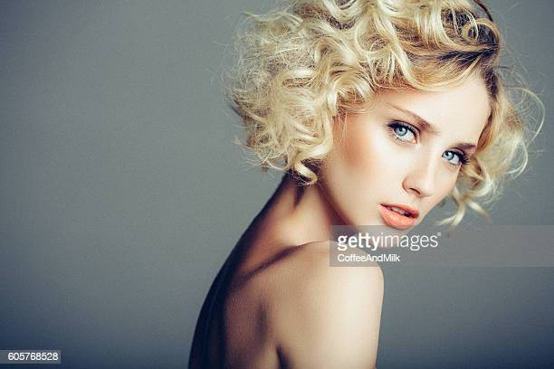beautiful woman with stylish hairstyle - pretty blondes stock pictures, royalty-free photos & images