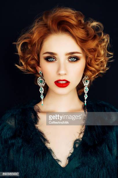 beautiful woman with stylish hairstyle - redhead stock pictures, royalty-free photos & images