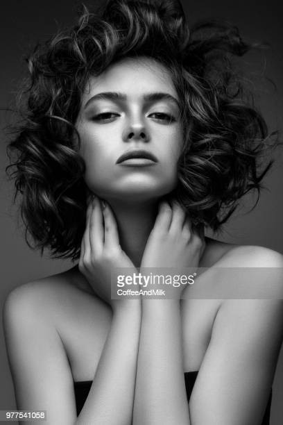 beautiful woman with stylish hairstyle - one young woman only stock pictures, royalty-free photos & images