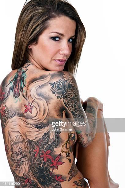 Beautiful woman with tattooed back