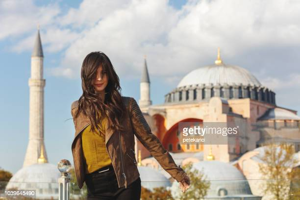 Beautiful woman with view of Hagia Sophia, Sultanahmet District, Istanbul, Turkey