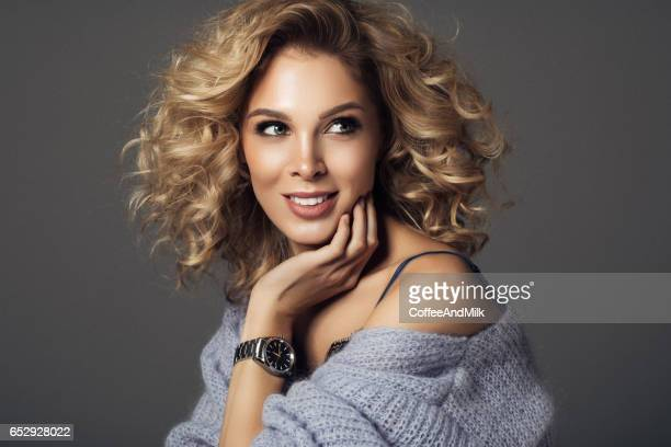 beautiful woman with watches - curly stock photos and pictures