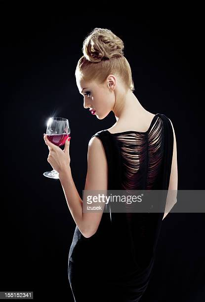 beautiful woman with wineglass - evening gown stock photos and pictures