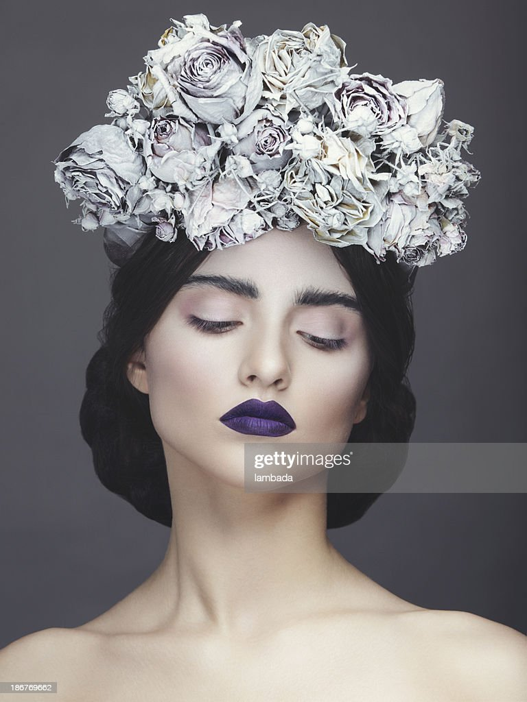 Beautiful woman with wreath of flowers : Stock Photo
