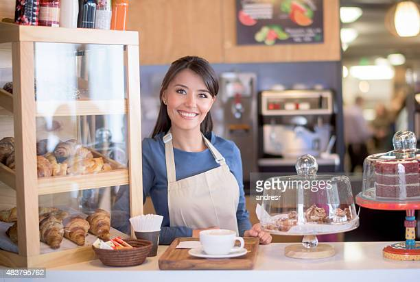 Beautiful woman working at a cafe