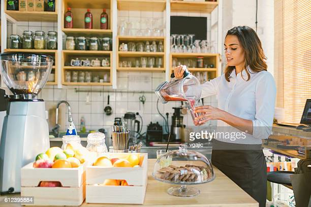 Beautiful Woman Working In Her Cafe