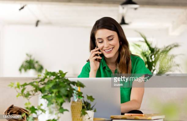 beautiful woman working on laptop in the eco-friendly office - izusek stock pictures, royalty-free photos & images