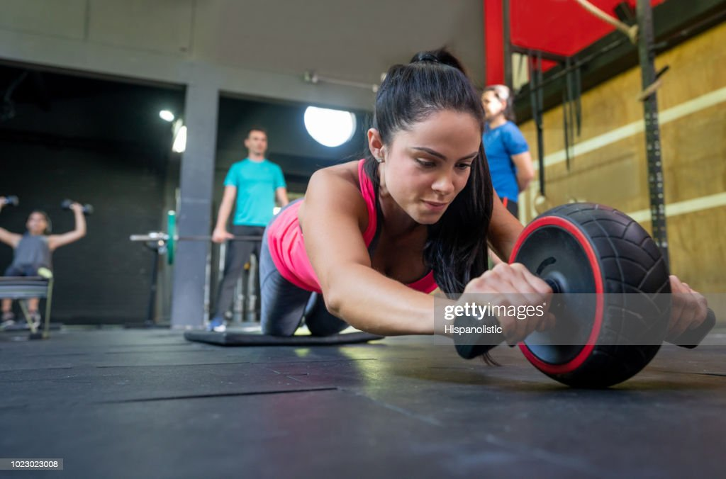 Beautiful woman working out at the gym with sports equipment : Stock Photo