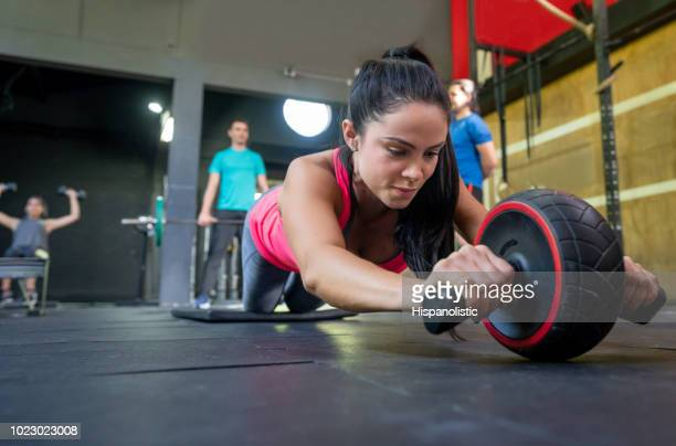 Beautiful woman working out at the gym with sports equipment