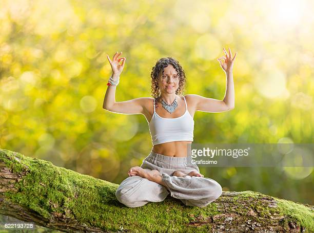 Beautiful woman Yoga concept posing exercises in forest