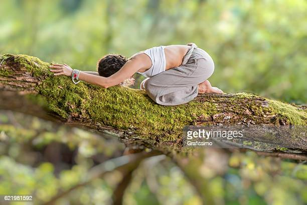 Beautiful woman Yoga posing exercises in forest