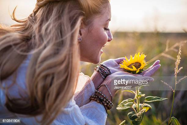 Beautiful womanl with sunflower outdoors