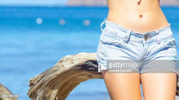 beautiful woman's belly button at the beach - waist stock pictures, royalty-free photos & images