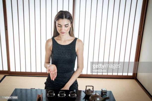 beautiful women are having asian tea ceremony - 和室 ストックフォトと画像