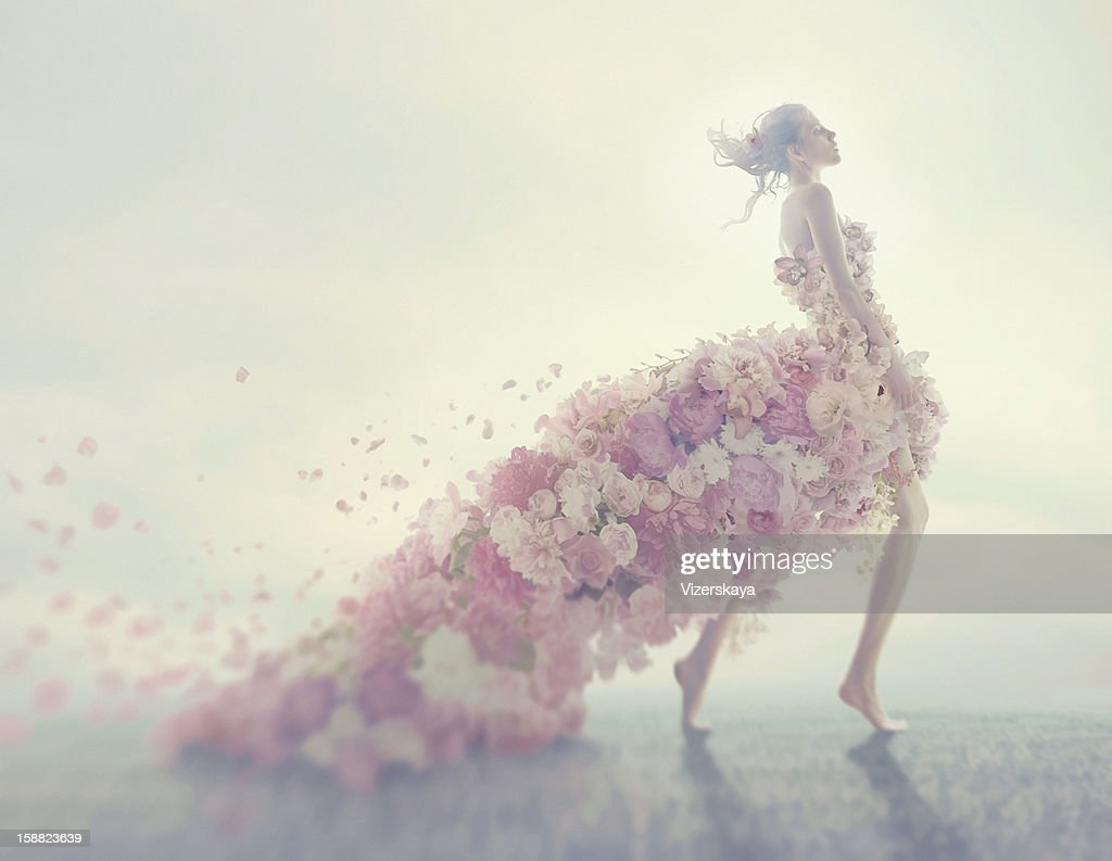 Flowers stock photos and pictures getty images beautiful women in flower dress izmirmasajfo