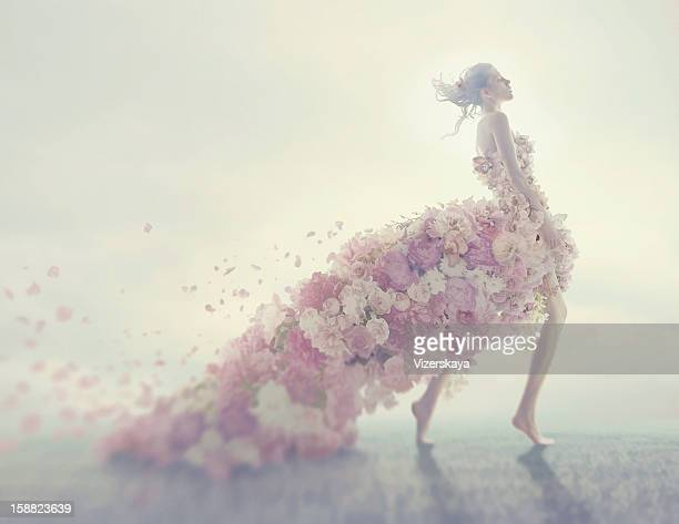 beautiful women in flower dress - skirt blowing stock photos and pictures