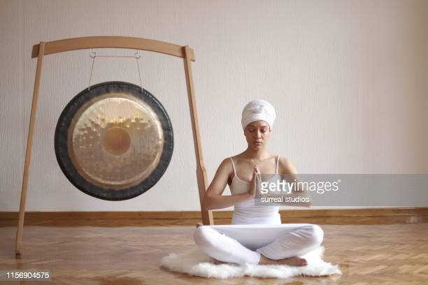 beautiful women in kundalini yoga meditation - gong stock photos and pictures