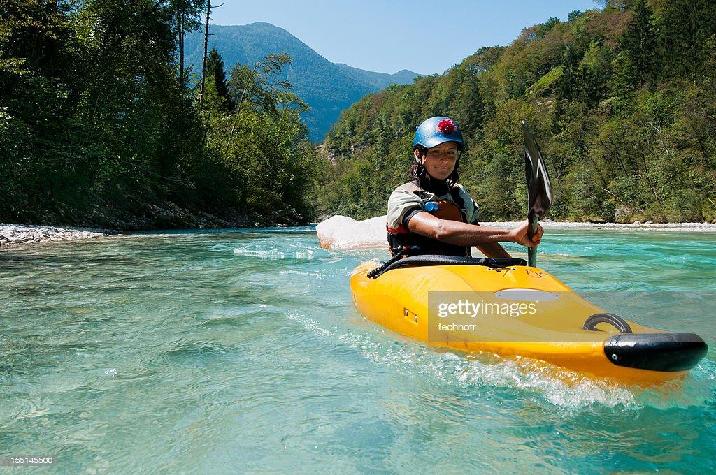 Beautiful women kayaking on turquoise mountain river : Stock Photo