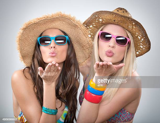 Beautiful Women on Vacation blowing Kisses