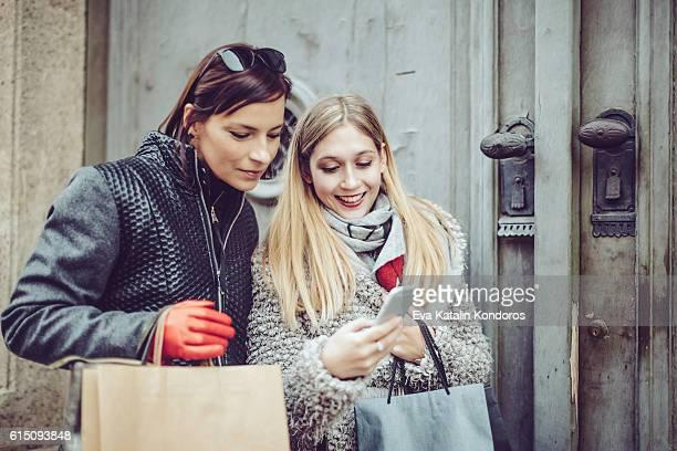 Beautiful women shopping in the city