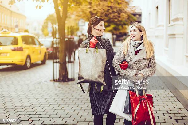 Beautiful women shopping in the city