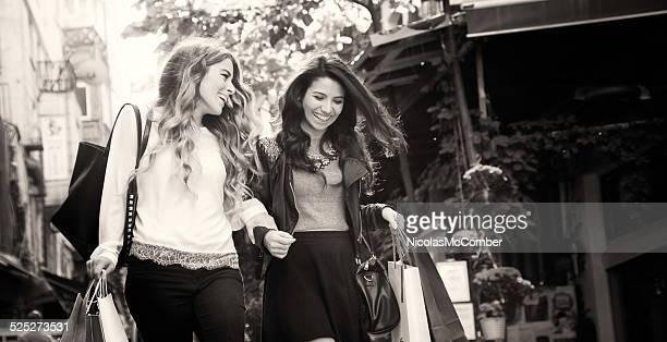 Beautiful women shopping sepia monochrome letterbox