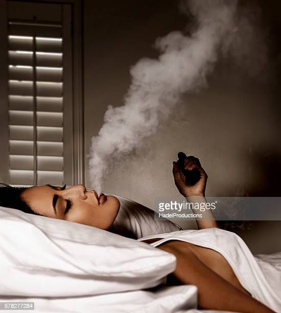 Beautiful women smoking an electronic cigarette