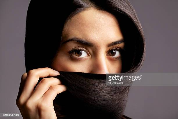 Beautiful women using her hair as a Hijab
