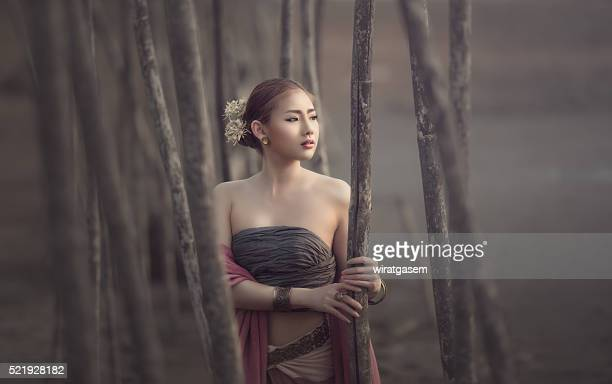 beautiful women wearing her traditional dress. - wiratgasem stock photos and pictures