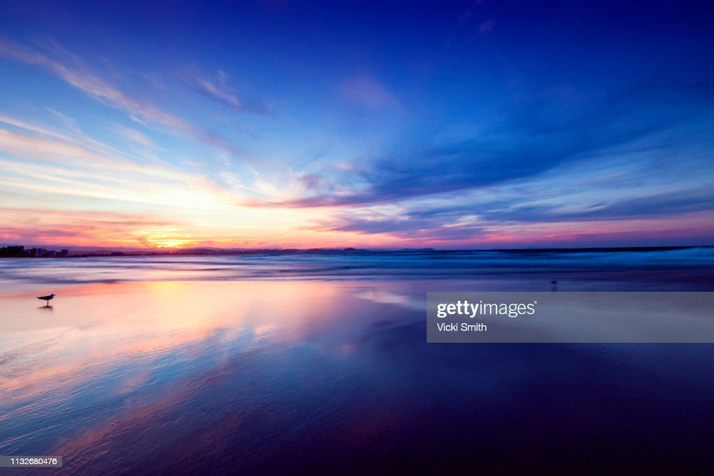 Beautiful yellow and blue sky Sunrise over the ocean : Stock Photo