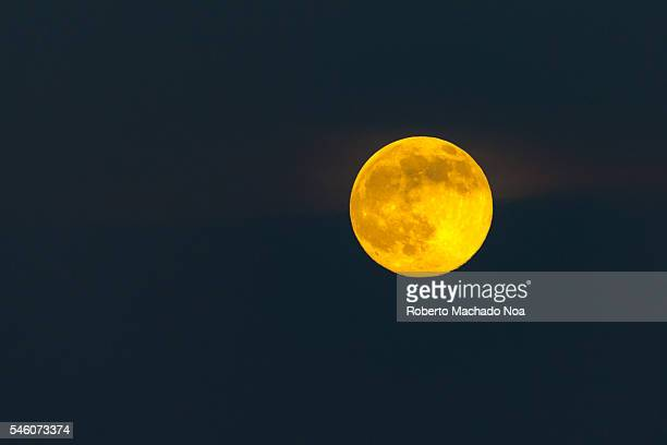 Beautiful yellow full solstice moon on a clear star less night